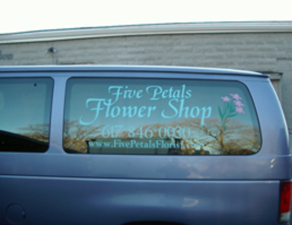 blue van with vinyl lettering